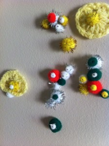 I started putting crochet yo-yos and pom-poms on the wall.